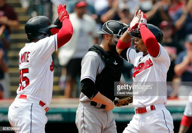 Francisco Lindor of the Cleveland Indians celebrates with Abraham Almonte after they scored on Lindor's a two run home run against the Colorado...