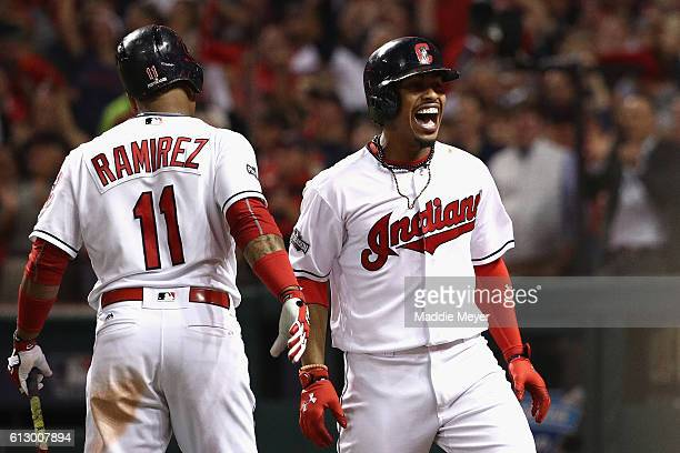 Francisco Lindor of the Cleveland Indians celebrates with Jose Ramirez after hitting a solo home run in the third inning against the Boston Red Sox...