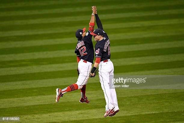 Francisco Lindor of the Cleveland Indians celebrates with Lonnie Chisenhall after defeating the Chicago Cubs 60 in Game One of the 2016 World Series...