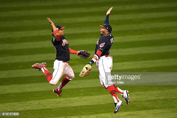 Francisco Lindor of the Cleveland Indians celebrates with Rajai Davis after defeating the Chicago Cubs 60 in Game One of the 2016 World Series at...