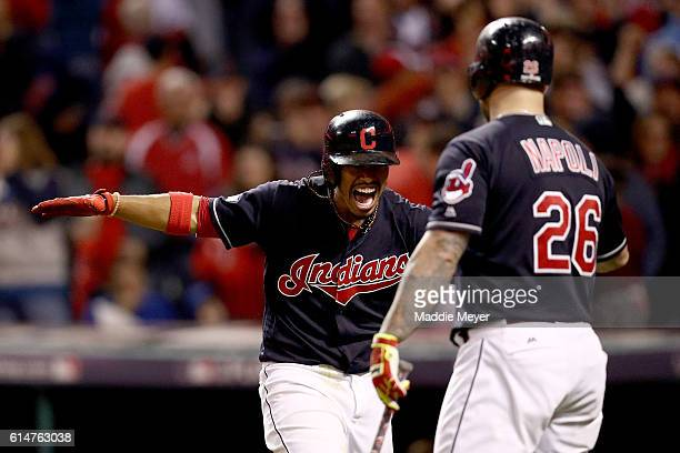 Francisco Lindor of the Cleveland Indians celebrates with teammate Mike Napoli after hitting a two run home run to right field against Marco Estrada...