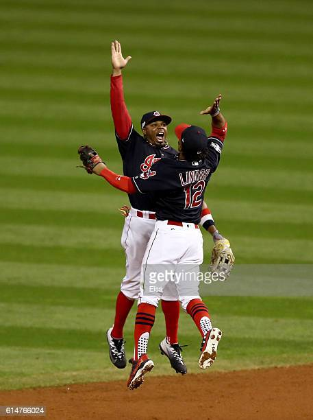 Francisco Lindor of the Cleveland Indians celebrates with teammate Rajai Davis after defeating the Toronto Blue Jays with a score of 2 to 0 in game...