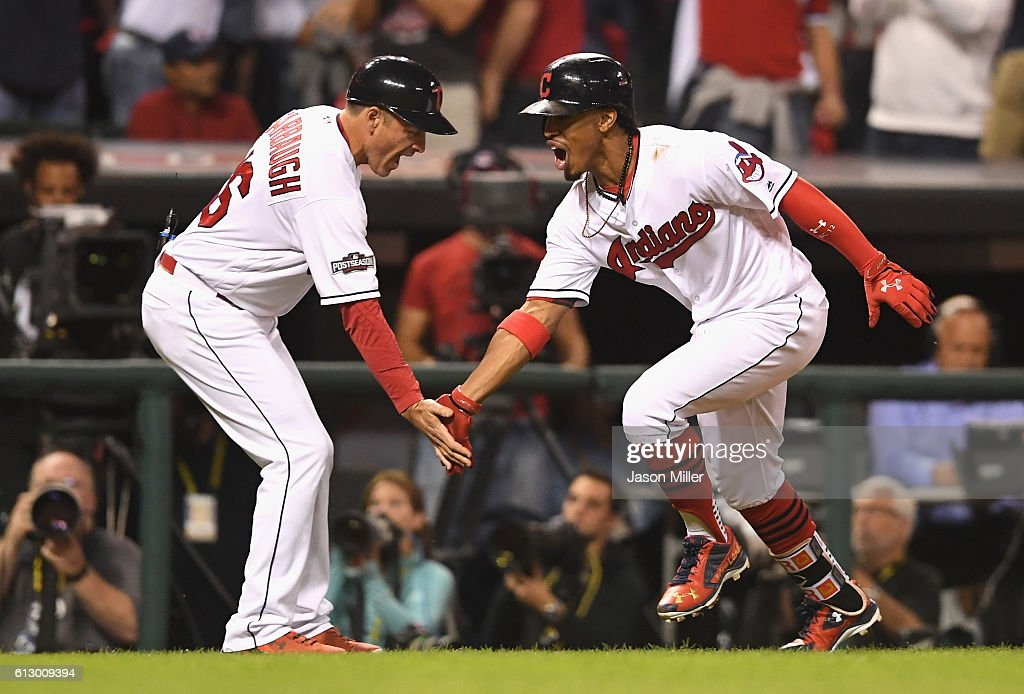 Francisco Lindor #12 of the Cleveland Indians celebrates with third base coach Mike Sarbaugh #16 after hitting a solo home run in the third inning against the Boston Red Sox during game one of the American League Divison Series at Progressive Field on October 6, 2016 in Cleveland, Ohio.
