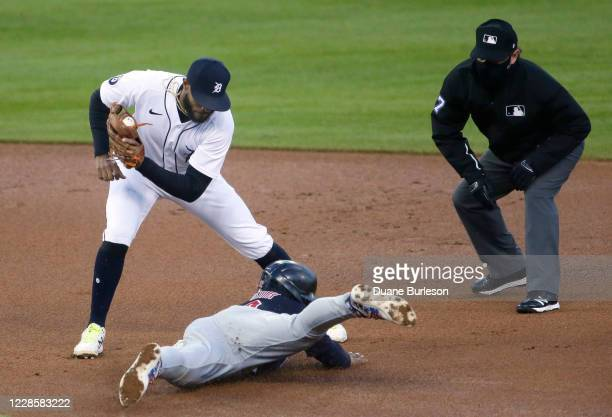 Francisco Lindor of the Cleveland Indians dives into first base ahead of the tag from shortstop Willi Castro of the Detroit Tigers to steal second...