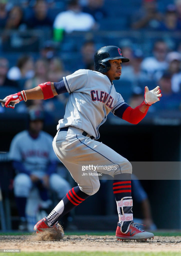 Francisco Lindor #12 of the Cleveland Indians follows through on a ninth inning single against the New York Yankees in the first game of a doubleheader at Yankee Stadium on August 30, 2017 in the Bronx borough of New York City.