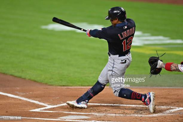 Francisco Lindor of the Cleveland Indians follows through on a solo home run in the first inning against the Cincinnati Reds at Great American Ball...