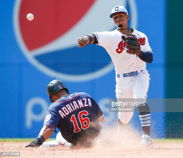 Robbie Grossman of the Minnesota Twins fields a single by Rajai Davis of the Cleveland Indians during the second inning at Progressive Field on June...