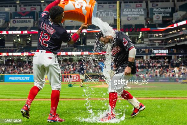 Francisco Lindor of the Cleveland Indians gives Jason Kipnis a Gatorade shower after Kipnis hit a walkoff grand slam to defeat the Chicago White Sox...