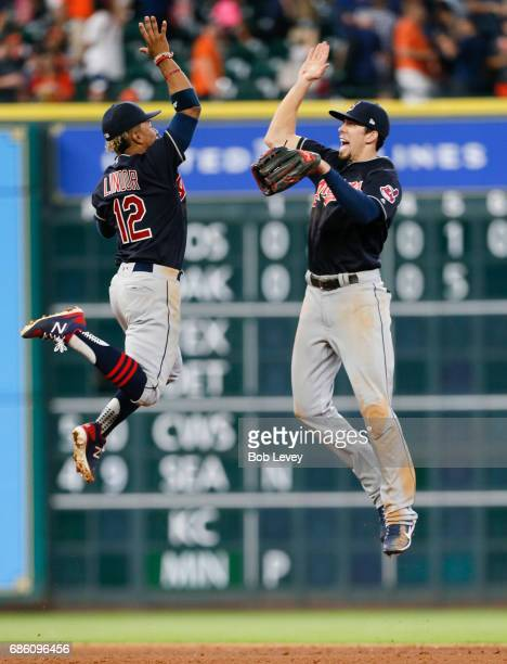 Francisco Lindor of the Cleveland Indians high fives Bradley Zimmer after the final out as the Cleveland Indians defeated the Houston Astros 30 at...