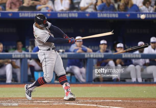 Francisco Lindor of the Cleveland Indians hits a brokenbat tw0run single in the fifth inning during MLB game action against the Toronto Blue Jays at...