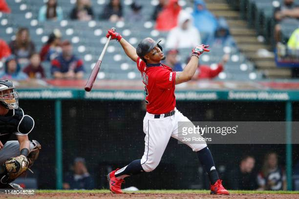 Francisco Lindor of the Cleveland Indians hits a double to deep right field to drive in a run in the fifth inning against the Chicago White Sox at...