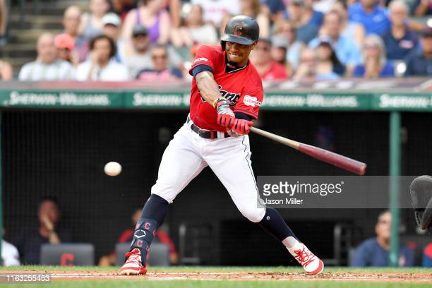 Francisco Lindor of the Cleveland Indians hits a single during the first inning against the Kansas City Royals at Progressive Field on July 20, 2019...