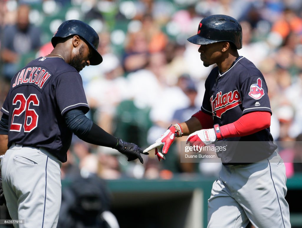 Francisco Lindor #12 of the Cleveland Indians is congratulated by Austin Jackson #26 after hitting a solo home run during the sixth inning at Comerica Park on September 3, 2017 in Detroit, Michigan.