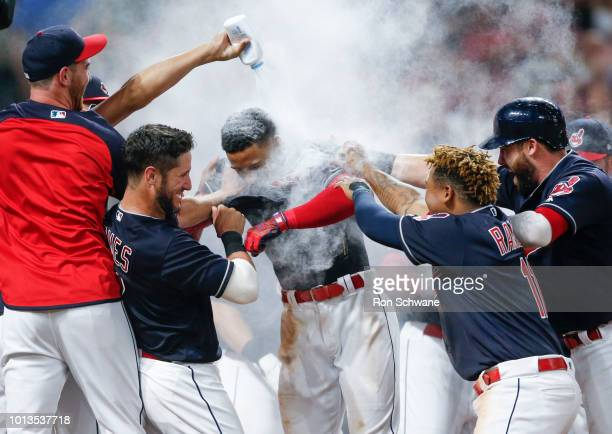 Francisco Lindor of the Cleveland Indians is mobbed by teammates after hittng a game winning three run home run off Trevor Hildenberger of the...