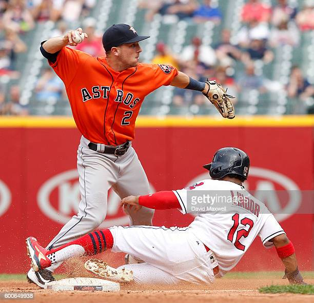 Francisco Lindor of the Cleveland Indians is out as second base as Alex Bregman of the Houston Astros throws to first for a double play in the sixth...