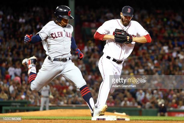 Francisco Lindor of the Cleveland Indians is safe at first base ahead of Rick Porcello of the Boston Red Sox in the sixth inning of a game at Fenway...