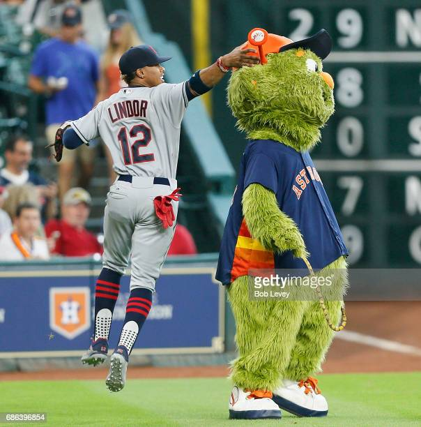 Francisco Lindor of the Cleveland Indians jokes arounnd with mascot Orbit of the Houston Astros at Minute Maid Park on May 21 2017 in Houston Texas