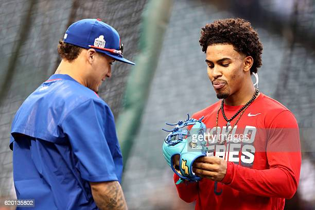 Francisco Lindor of the Cleveland Indians looks at the glove of Javier Baez of the Chicago Cubs during batting practice prior to Game Six of the 2016...