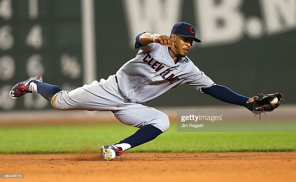 Francisco Lindor #12 of the Cleveland Indians makes a diving grab but fails to throw out Rusney Castillo #38 of the Boston Red Sox for the out allowing a run to score in the fifth inning at Fenway Park on August 18, 2015 in Boston, Massachusetts.