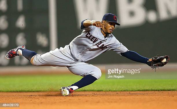 Francisco Lindor of the Cleveland Indians makes a diving grab but fails to throw out Rusney Castillo of the Boston Red Sox for the out allowing a run...