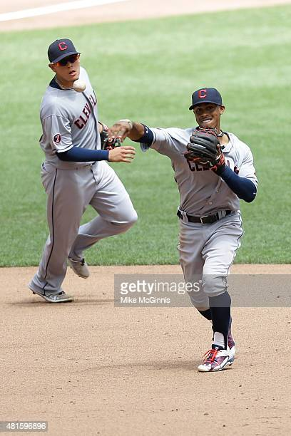 Francisco Lindor of the Cleveland Indians makes the throw to first base to retire Khris Davis of the Milwaukee Brewers in the third inning during the...