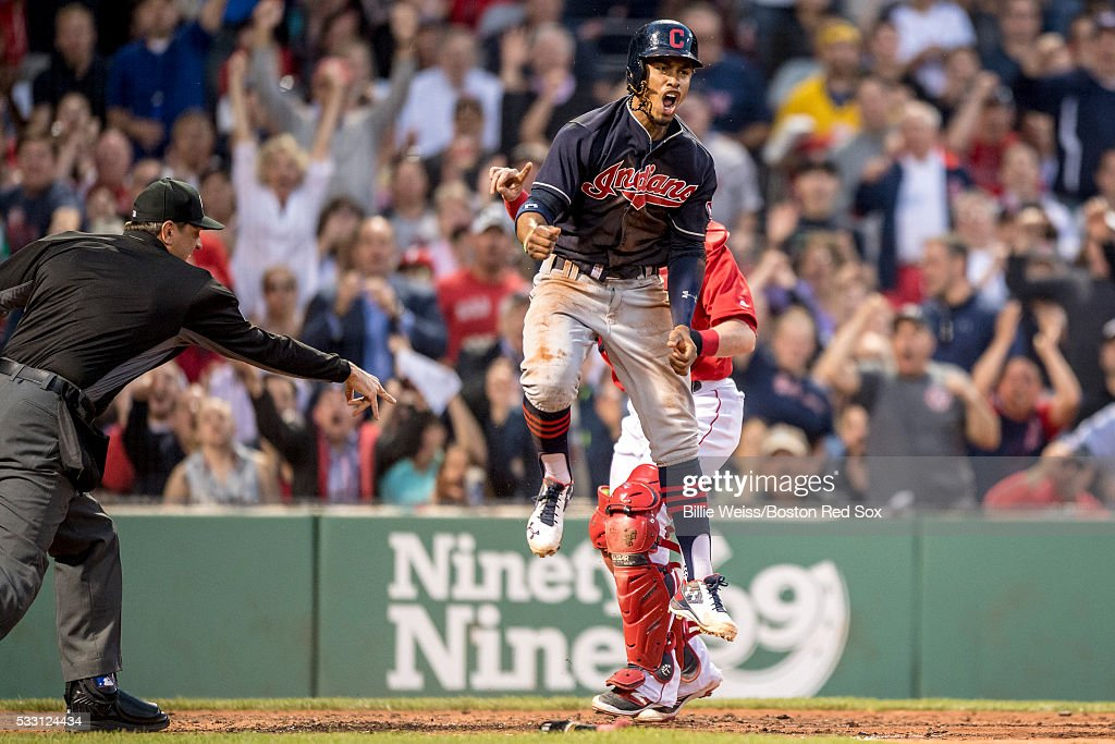 Francisco Lindor #12 of the Cleveland Indians reacts after avoiding the tag of Christian Vazquez #7 of the Boston Red Sox as he scores during the third inning of a game on May 20, 2016 at Fenway Park in Boston, Massachusetts.