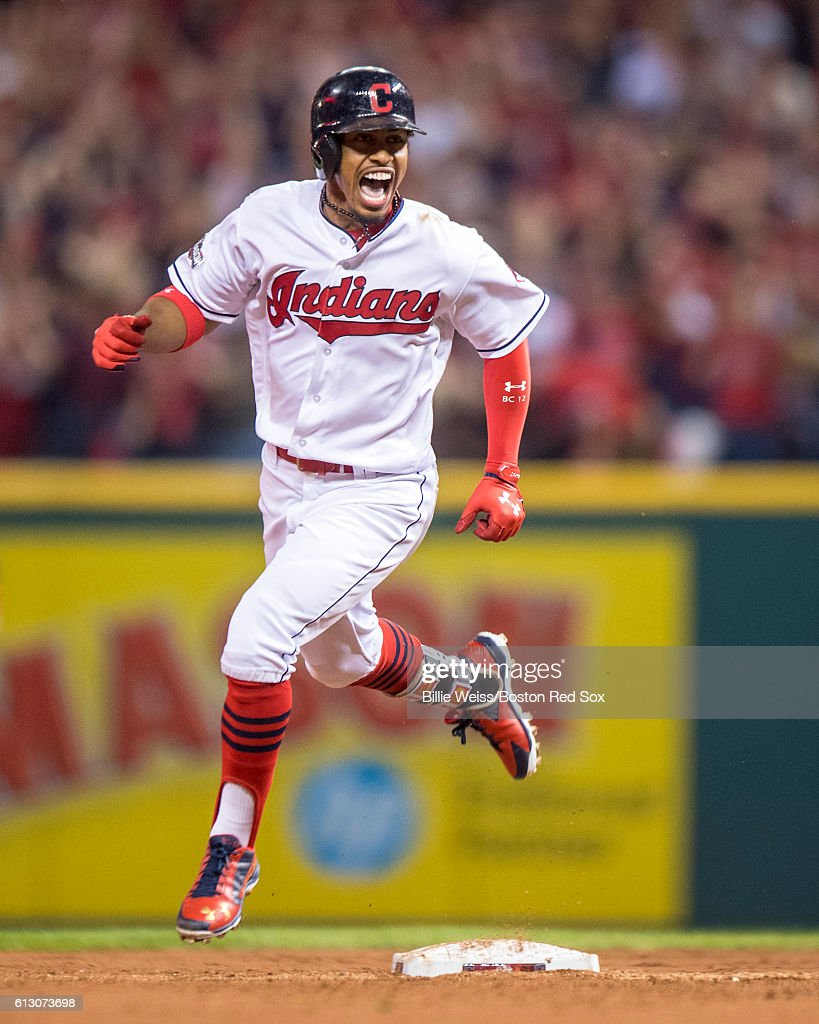 Francisco Lindor #12 of the Cleveland Indians reacts after hitting a solo home run during the third inning of game one of the American League Division Series against the Boston Red Sox on October 6, 2016 at Progressive Field in Cleveland, Ohio.