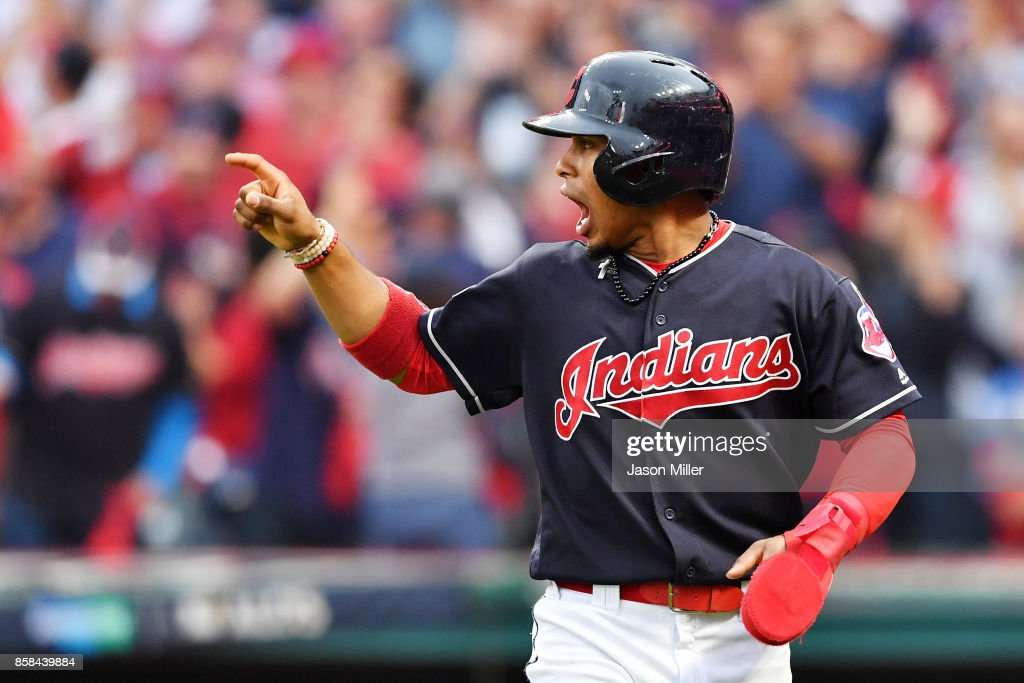 Francisco Lindor #12 of the Cleveland Indians reacts after scoring on a hit by Carlos Santana #41 in the first inning against the New York Yankees during game two of the American League Division Series at Progressive Field on October 6, 2017 in Cleveland, Ohio.