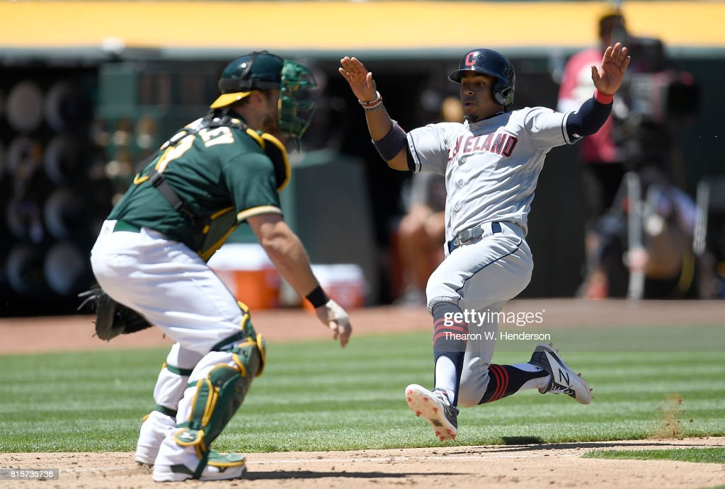 Francisco Lindor #12 of the Cleveland Indians scores against the Oakland Athletics in the top of the fouth inning at Oakland Alameda Coliseum on July 16, 2017 in Oakland, California.