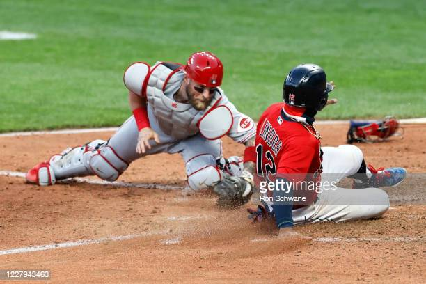 Francisco Lindor of the Cleveland Indians scores past Tucker Barnhart of the Cincinnati Reds on a single by Franmil Reyes IN the seventh inning at...
