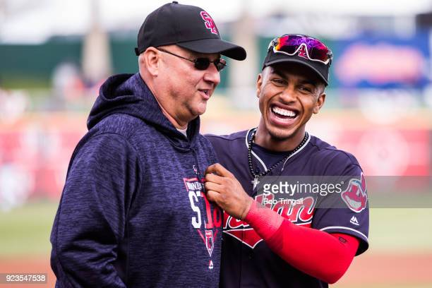 Francisco Lindor of the Cleveland Indians shares a laugh with manager Terry Francona before a game against the Cincinnati Reds during a Spring...