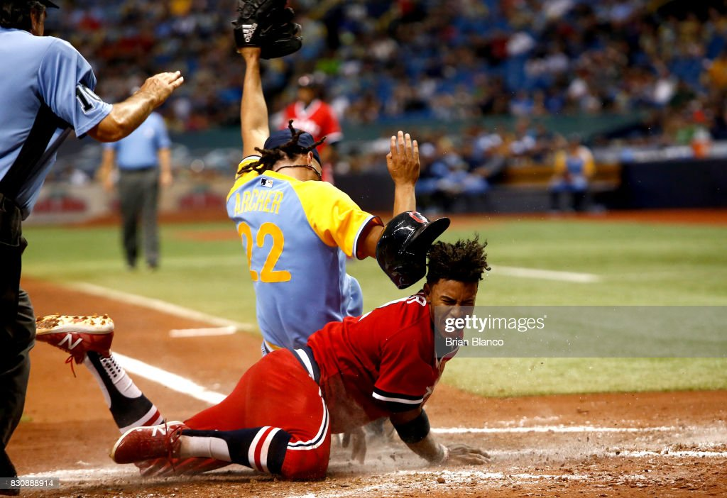 Francisco Lindor #12 of the Cleveland Indians slides home ahead of pitcher Chris Archer #22 of the Tampa Bay Rays to score off of the wild pitch by Archer during the third inning of a game on August 12, 2017 at Tropicana Field in St. Petersburg, Florida.