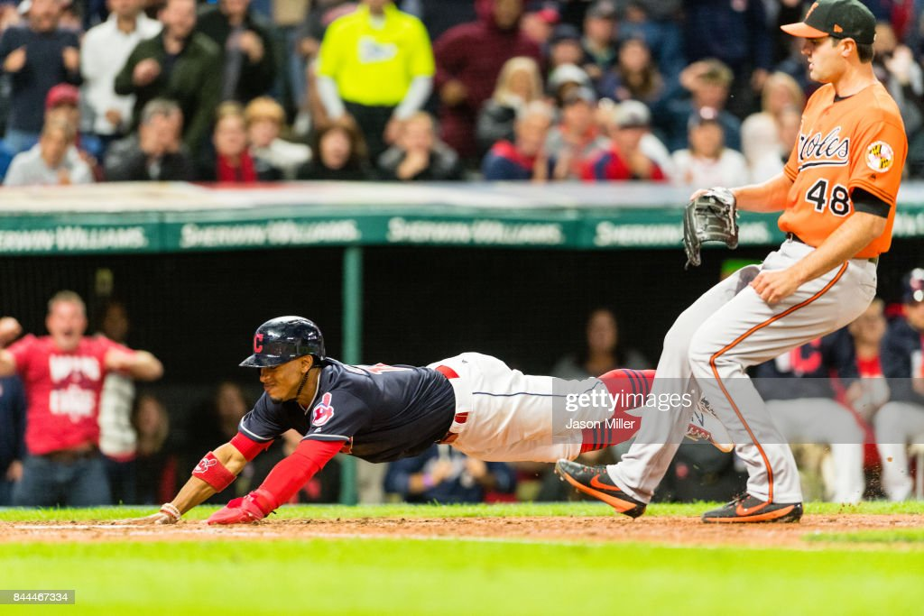 Francisco Lindor #12 of the Cleveland Indians steals home on a wild pitch from Richard Bleier #48 of the Baltimore Orioles during the seventh inning at Progressive Field on September 8, 2017 in Cleveland, Ohio.