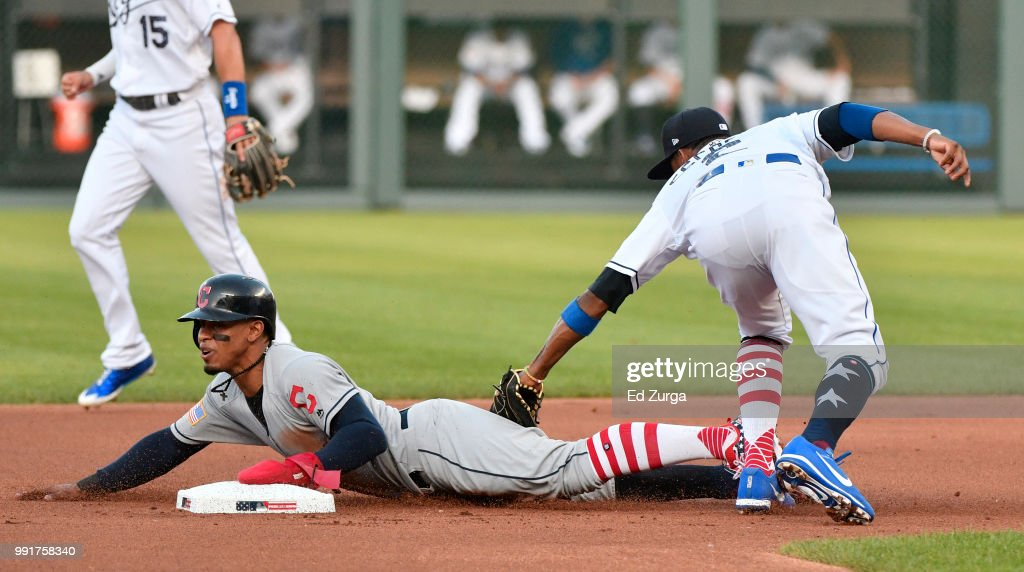 Francisco Lindor #12 of the Cleveland Indians steals second base ahead of the tag of Alcides Escobar #2 of the Kansas City Royals in the first inning at Kauffman Stadium on July 4, 2018 in Kansas City, Missouri.