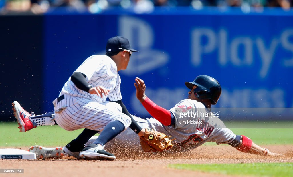 Francisco Lindor #12 of the Cleveland Indians steals second base during the first inning ahead of the tag from Ronald Torreyes #74 of the New York Yankees in the first game of a doubleheader at Yankee Stadium on August 30, 2017 in the Bronx borough of New York City.