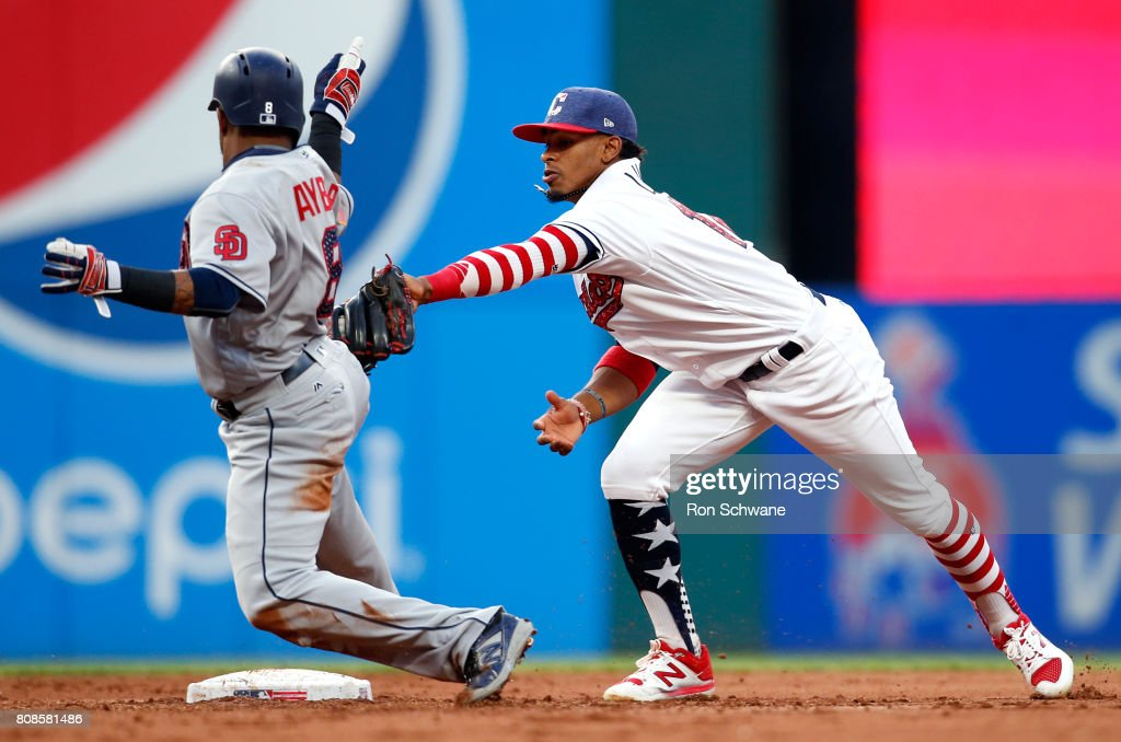 Francisco Lindor #12 of the Cleveland Indians tags out Erick Aybar #8 of the San Diego Padres on a fielders choice by Cory Spangenberg #15 during the fifth inning at Progressive Field on July 4, 2017 in Cleveland, Ohio.