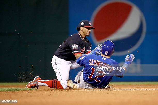 Francisco Lindor of the Cleveland Indians tags out Kyle Schwarber of the Chicago Cubs as he attempts to stretch the play after hitting a single...