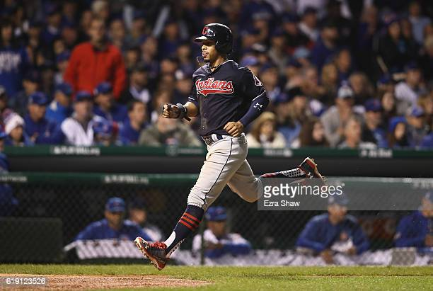 Francisco Lindor of the Cleveland Indians tags up from third base to score a run in the sixth inning against the Chicago Cubs in Game Four of the...