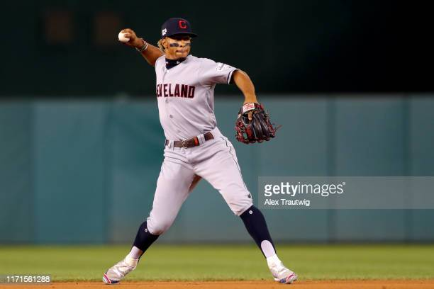 Francisco Lindor of the Cleveland Indians throws to first for the out during the game between the Cleveland Indians and the Washington Nationals at...