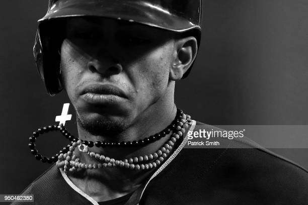 Francisco Lindor of the Cleveland Indians walks off of the field after popping out against the Baltimore Orioles at Oriole Park at Camden Yards on...