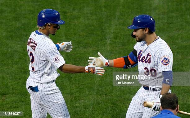 Francisco Lindor of the New York Mets celebrates his two-run home run with teammate Michael Conforto in the sixth inning against the Miami Marlins at...