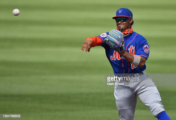 Francisco Lindor of the New York Mets makes the throw to first base for the out in the fourth inning against the Miami Marlins in a spring training...