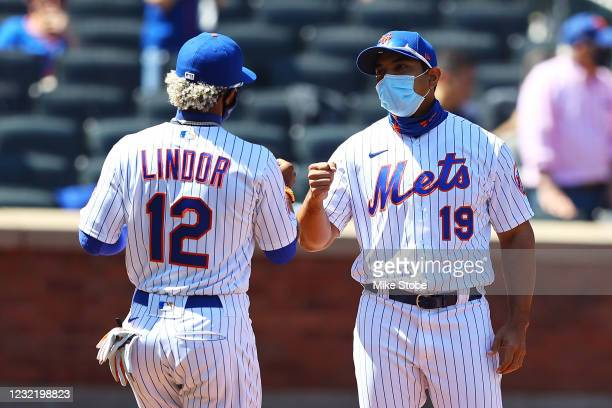 Francisco Lindor of the New York Mets pumps fist with manager Luis Rojas during player introductions prior to the game against the Miami Marlins at...