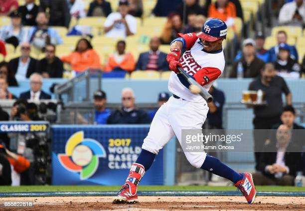 Francisco Lindor of the Puerto Rico hits a double in the first inning against team Netherlands during Game 1 of the Championship Round of the 2017...