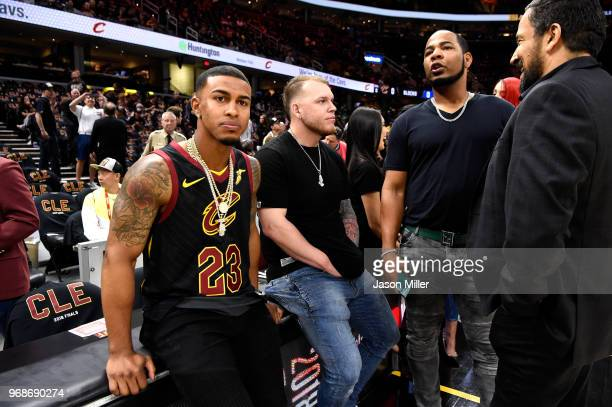 Francisco Lindor Roberto Perez and Edwin Encarnacion of the Cleveland Indians look on from the sideline during warm ups prior to Game Three of the...