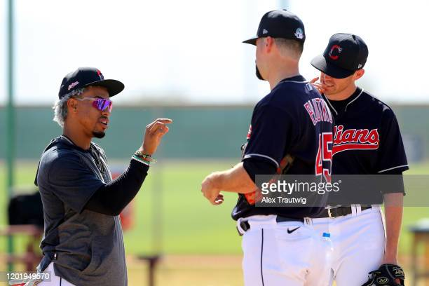 Francisco Lindor speaks with Shane Bieber and Adam Plutko of the Cleveland Indians during a workout on Wednesday, February 19, 2020 at Goodyear...