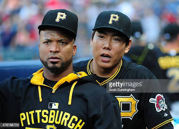 Francisco Liriano and Jung Ho Kang of the Pittsburgh Pirates relax in the dugout before the game against the Atlanta Braves at Turner Field on June 6...