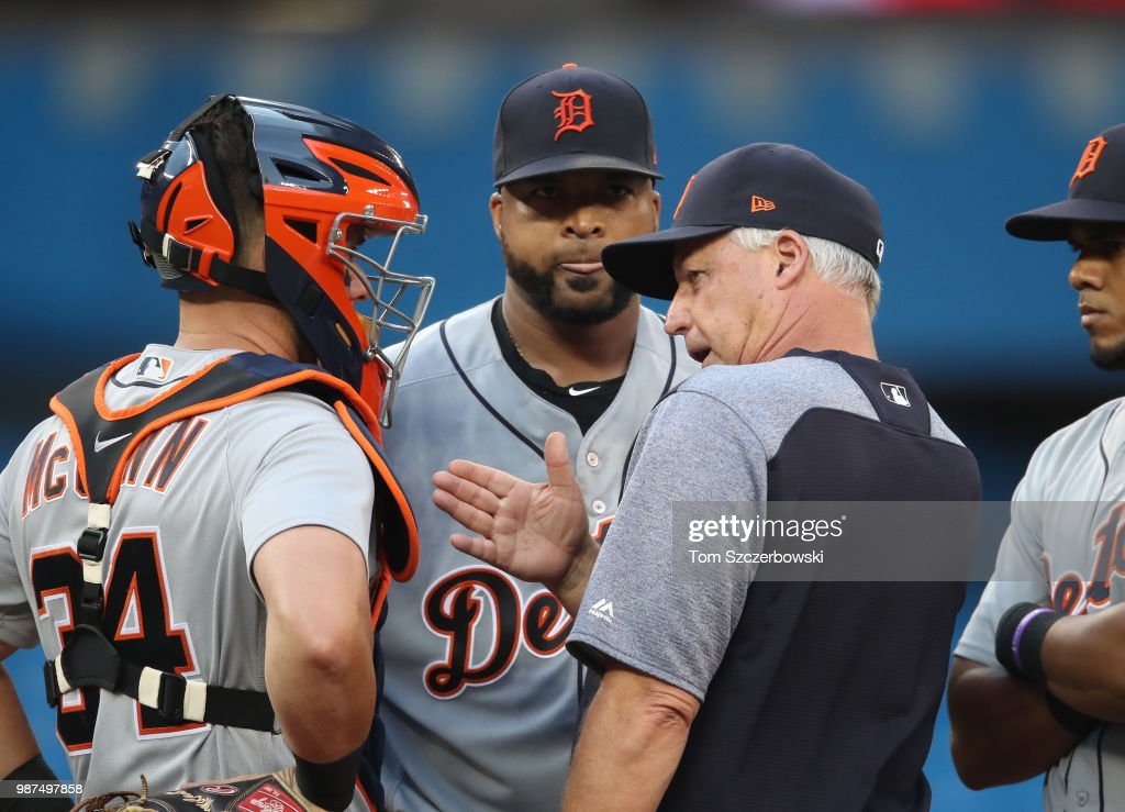 Francisco Liriano #38 of the Detroit Tigers is visited on the mound by pitching coach Rick Anderson #4 in the fourth inning during MLB game action against the Toronto Blue Jays at Rogers Centre on June 29, 2018 in Toronto, Canada.