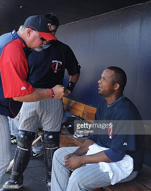 Francisco Liriano of the Minnesota Twins is congratulated by Manager Ron Gardenhire during a Grapefruit League Spring Training Game against the New...