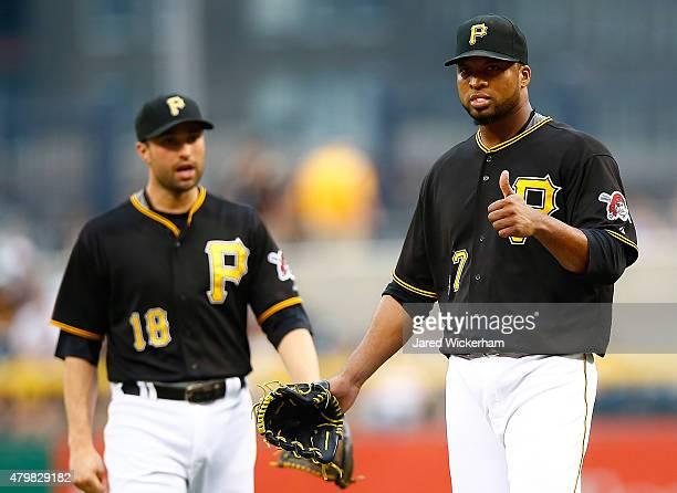 Francisco Liriano of the Pittsburgh Pirates signals that he's OK after taking a line drive off of his back in the second inning against the San Diego...